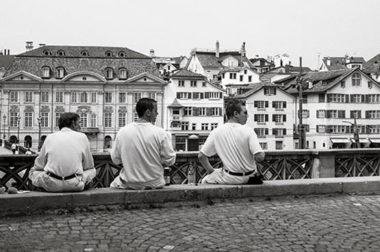 3 men sitting